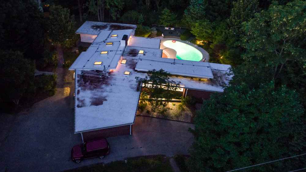 Drone shot of the house/pool area at night