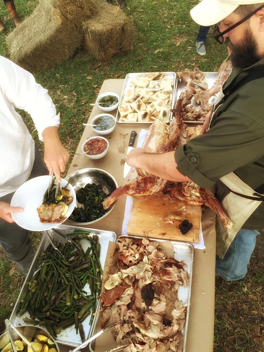 Lamb asador charred vegetables and sauces.