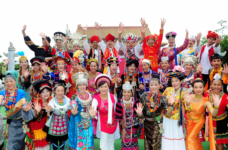 *Young minority actors/workers dress in their own ethnic garments at Splendid China Folk Village theme park in Shenzhen, China