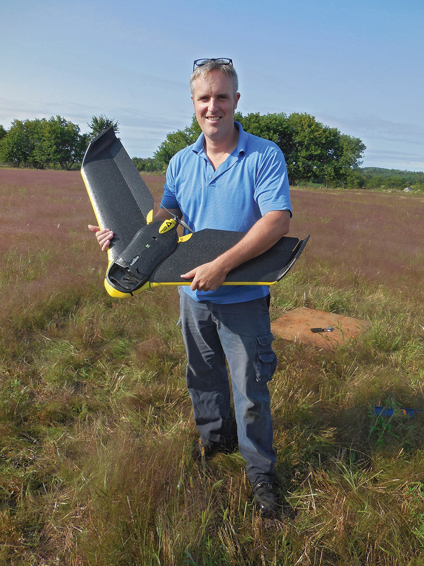 Kevin Smith of Stirling's P.A. Miller Surveying proudly shows off the latest in land surveying technology. According to USA Today, aerial surveys rank among the top uses for drones. Photo by Angela Hawn