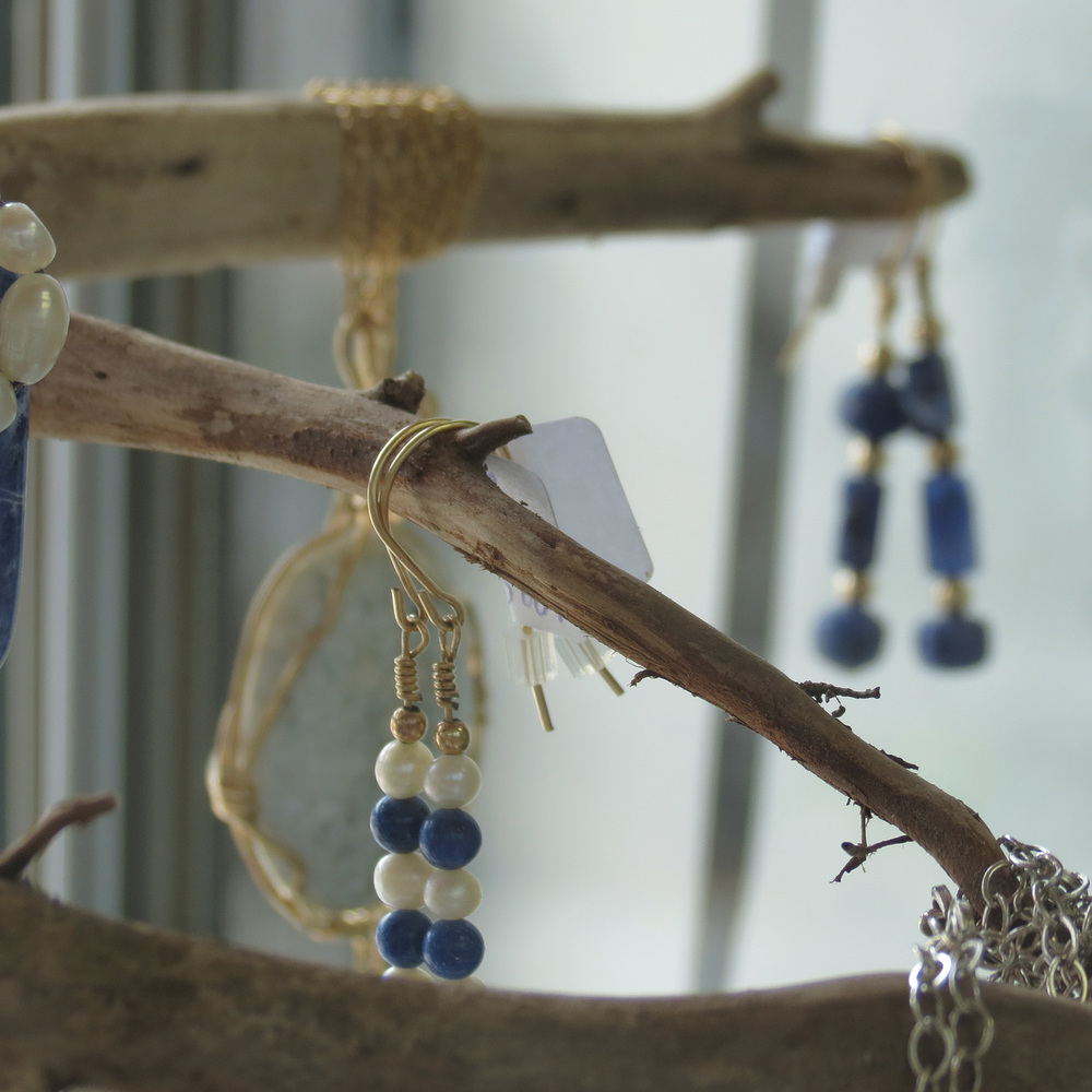 In addition to her work with driftwood and painting, Monteith is also a lapidary jewelry designer