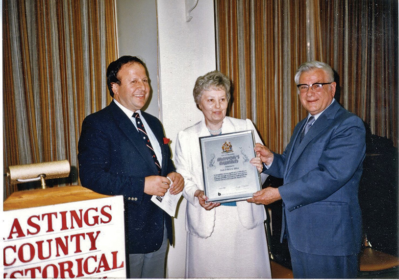 Former mayor of Belleville, George Zegouras, is shown with Nick and Helma Mika during a tribute to the popular local book publishers. Mayor Zegouras often presented Belleville's VIP visitors with a Mika-published book.