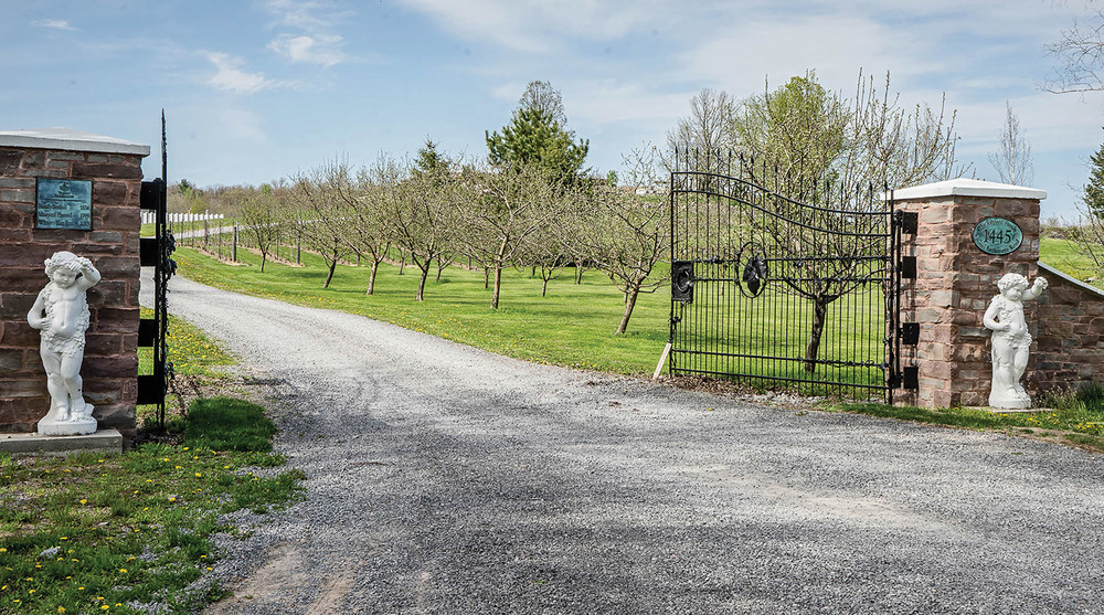 Upon arrival, you can't miss the hand forged gates of Potter Settlement Artisan Winery in Tweed.  Photo by Gail Burstyn