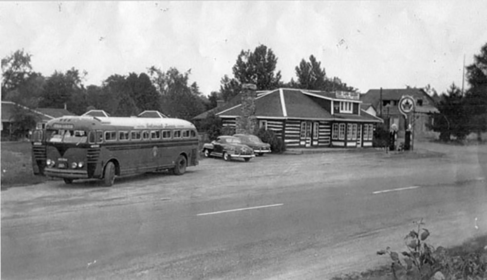 The Log Cabin was a busy spot at the time this photo was taken around 1950. With Highway 7 established as a major route connecting Toronto and Ottawa, cars and buses would often pull in for food and gas.  Photo courtesy Tweed Heritage Centre/Tweed News