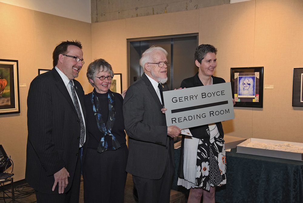 A longtime champion of the region's history, Gerry Boyce was recognized by having the new archives' reading room named for him. He was presented with the room's sign by Archivist Amanda Hill with son Egerton and wife Bev in attendance.Photo by Bob House / courtesy Community Archives of Belleville and Hastings County