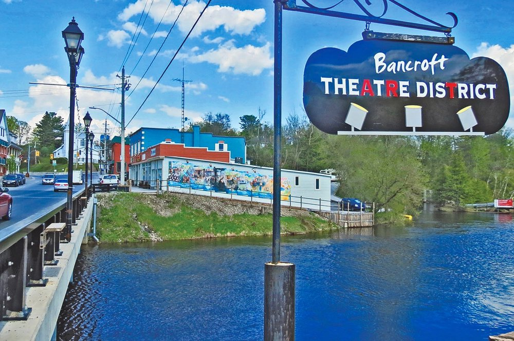 A fourth bridge is accentuated by a mural painted by Arne Roosman and a boardwalk path in Bancroft's Theatre District. A multi-unit apartment building near the corner of Bridge St. and Highway 62 was once a Mill powered by a 40-foot wooden flume.