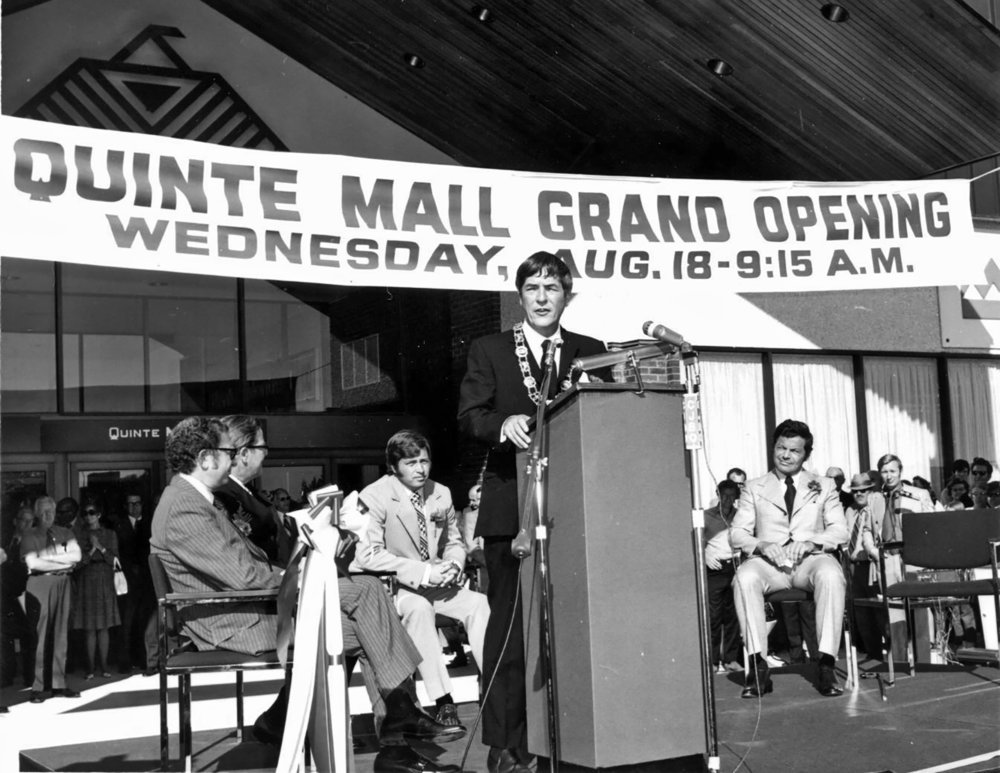 Mayor Russell Scott presides at the podium during the official opening ceremony of the Quinte Mall. Among his numerous positions and roles in the community, Dr. Scott was Mayor of Belleville from 1968 to 1972. Photo courtesy of the Belleville and Hastings County Community Archives