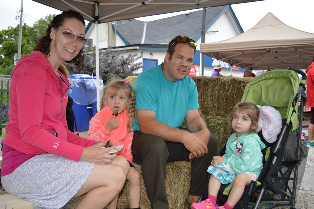 The Bergsma family from Frankford take a snack break at last year's Water Buffalo Festival on Mill Street in Stirling. Despite occasional rain showers the event drew well over 2,500 people.