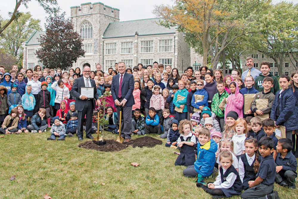 Albert College is rooted in Canadian history; now more than ever. An oak tree species native of Vimy Ridge — sight of one of the Canadian Forces' defining battles — was planted on the grounds of the Belleville independent school on October 13. Bay of Quinte MP Neil Ellis (right) and Albert College Head of School Keith Stansfield, with students behind them, show the Vimy Oak tree planted at the school. Photo courtesy Albert College