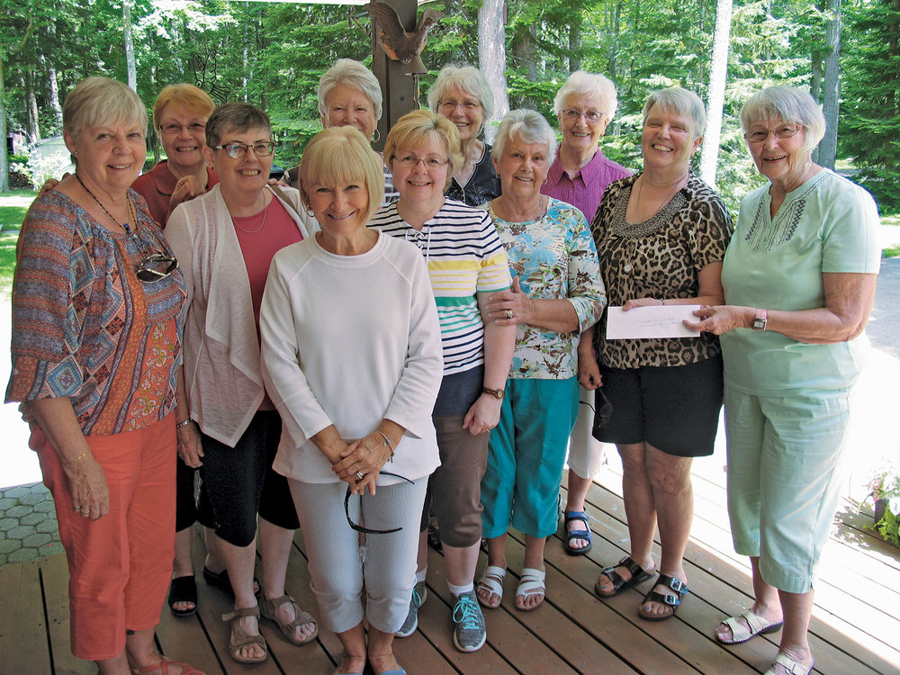 Dorothy Caverly (right) started the 'Silver Foxes' over a decade ago after returning from a visit to Florida. In this photo she presents a cheque to Norma Croft of the Marmora Garden Club.