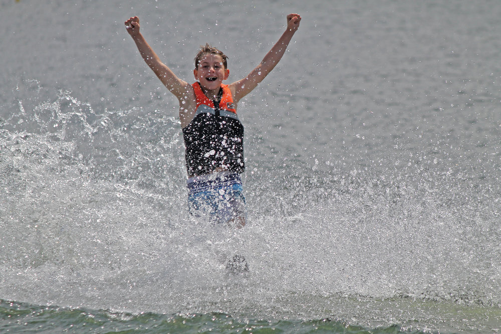 Camp-Can Aqua on Beaver Lake, offers a variety of watersports including waterskiing, sailing, windsurfing, paddle-boarding, kayaking, canoeing, and swimming lessons. Photo Courtesy of Camp Can Aqua.
