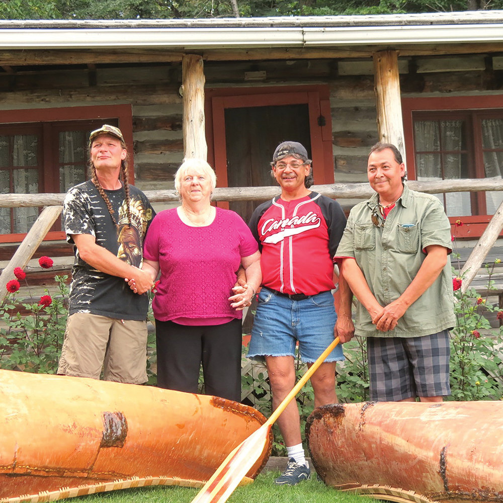 Stephen Hunter holds hands with former Kijicho Manito Chief Catherine Cannon, Chuck Commanda, and Jerry Wilson at the traditional home of Stephen's Grandfather, at Ron and Sonya Emond's home on North Baptiste Road, in Hastings Highlands, in 2016.