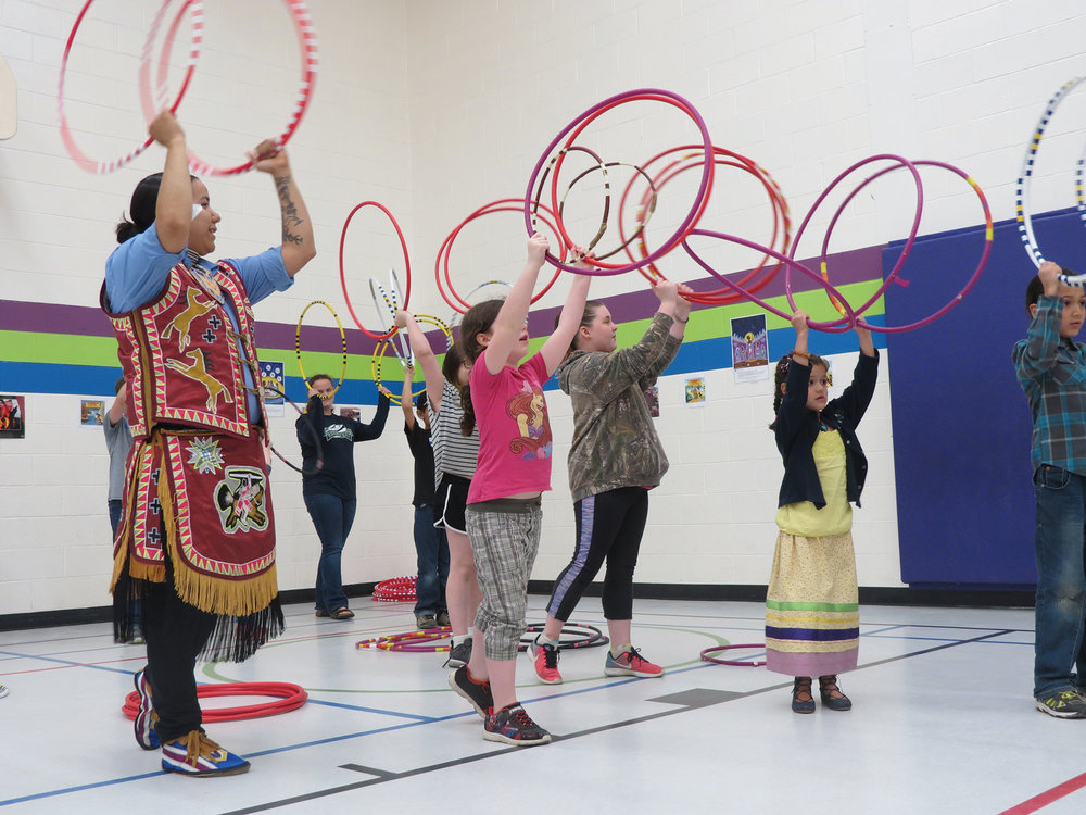 Beany John shares Hoop dancing skills with students at York River Public School in Bancroft, as part of the Indigenous Education Open House, on May 3, 2018. Children from Bancroft participate.