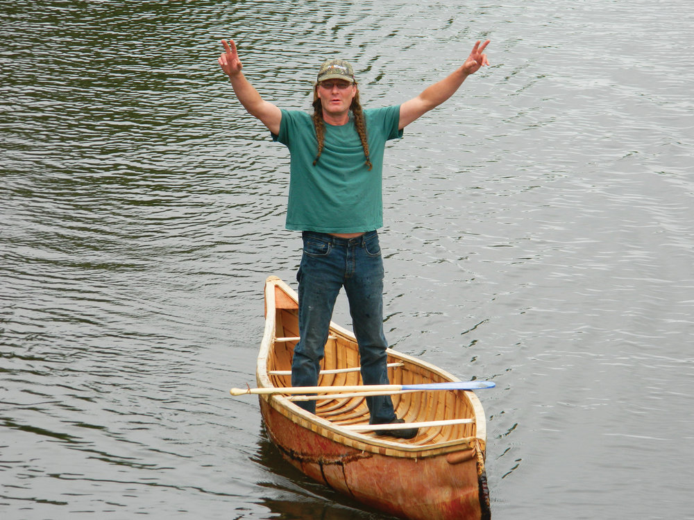 Stephen Hunter on the York River tests a birch bark canoe that he made with Chuck Commanda, in 2016, at Millennium Park, as part of a community build in Bancroft.
