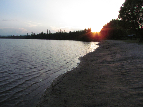 Foster Lake Beach is perfect for a romantic stroll at sunset.