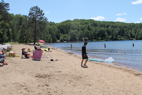 The public beach at Papineau Lake is a favourite for kids and adults alike.