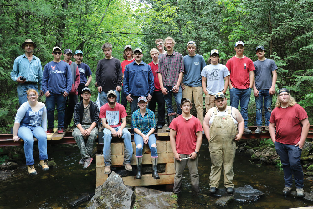 Community involvement has included these local students and their teacher who helped to rebuild the bridge. Photo courtesy Central Hastings Secondary School.