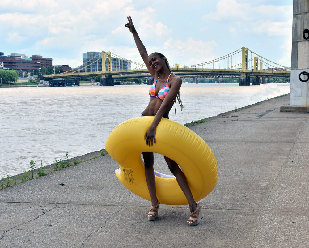Nadia striking a pose with our donut pool float!