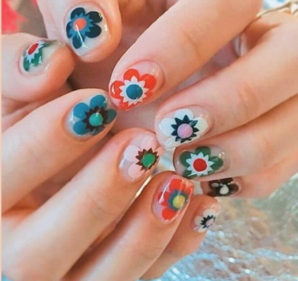 Bring some vintage flare into your look with these 60s & 70s-inspired flower motifs! Use any solid color as a base (clear looks great) and have fun with colors and designs.  Tip: Let each layer dry  completely  before moving onto the next!