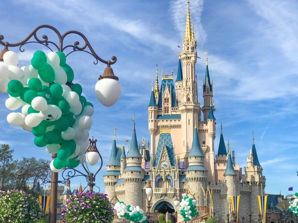 Hundreds of green and white Mickey balloons filled the castle hub.