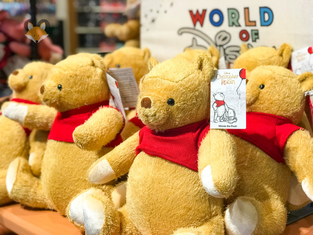 Pooh has a cute red shirt and rotating arms.