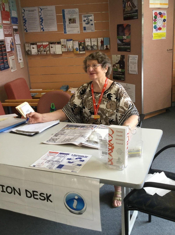 A volunteer at the Information Desk.