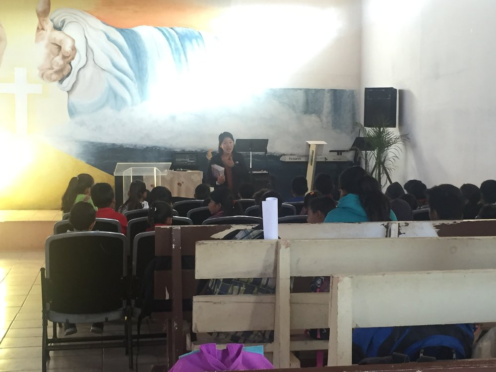Andrea preaching at morning chapel at El Porvenir Primaria in Spanish!