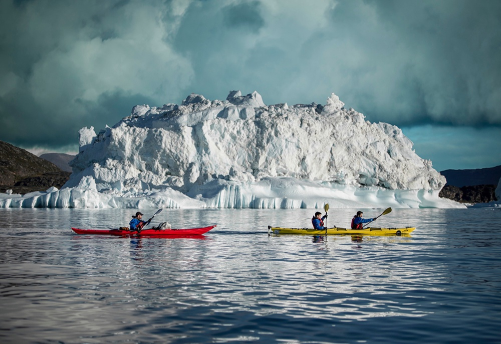 Kayaking amongst icebergs, Greenland | photo Mads Pihl