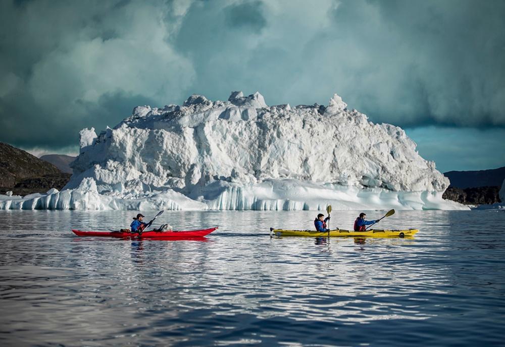 Kayaking amongst icebergs, Greenland | Mads Pihl