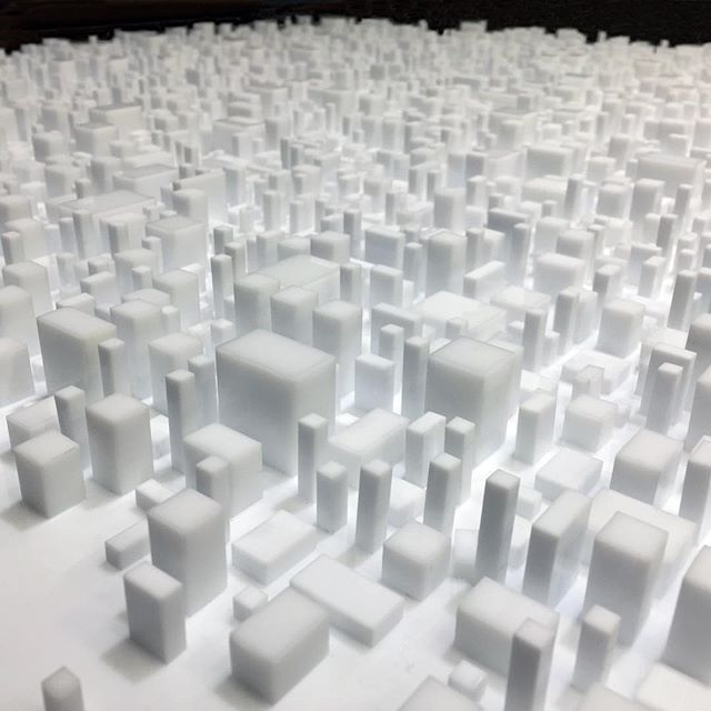 Wonder Where We Land, my latest piece and its army of vertical soldiers spreading frantically always further... Link in bio.  Photo by Nathalie Vin.  @vinnathalie #city #cities #architecture #design #art #artist #photooftheday #light #shadow #cineticart #photography #white #future #life #human #earth #exodus #dystopia