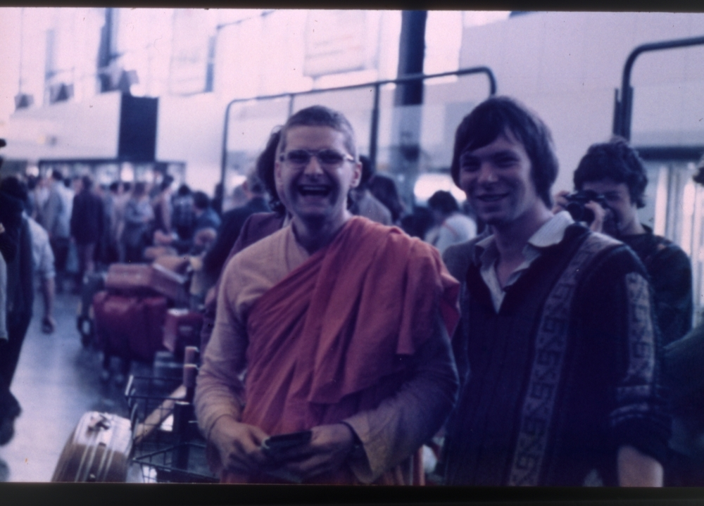 This is me and Kularatna at London airport when we were leaving for India. This was my second time back to India as a monk and I had decided to come out and live here.          You look very happy here.     I was. God, life in Britain! There was nothing to attract me there. This was a new lease of life. Britain was boring then… No I had nothing, no future in England. I mean, I can't stand living in India at times, but I don't mind all of life here. It's not a bed of roses, as they say. But I wanted to leave England also because when I had come to India for the very first time in 1969 to 70 for seven months, I found it very freeing culturally. I'd never been out of Europe before. India was a completely different environment. So many of my old cultural assumptions were dissolved and I found it very freeing psychologically. When I went back to England then I found that gradually, the old conditioning was taking over, so I wanted a prolonged period away from Europe. And this was an opportunity.