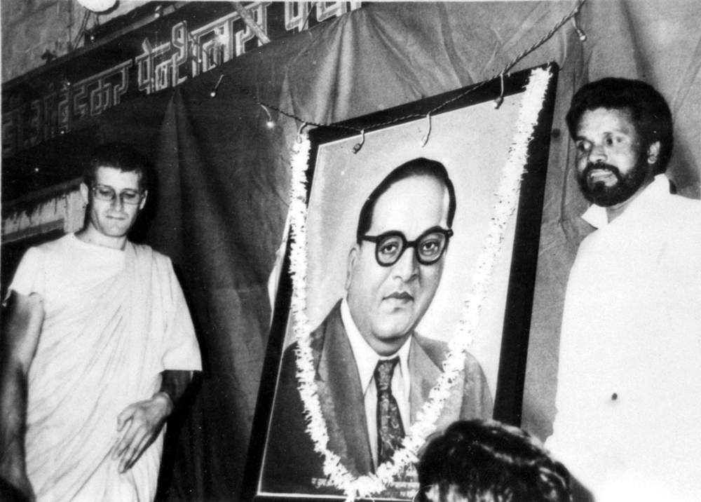 Ambedkar had converted to Buddhism in 1956.  He'd been born an untouchable and he suffered a great deal in his childhood from untouchability, and struggled to get an education, but he managed to become one of the first untouchables to matriculate. With help from progressive leaders like the Maharaja of Kolhapur he finished his education abroad in America, at Columbia, studying under John Dewey, and then in England and Germany too. He came back one of the most educated people in India at that point but couldn't get a job in government service because of his status as an untouchable. That started his social career. He was intelligent, educated, had worked in Politics, Law, and Economics, and brought about lots of reforms in these areas, especially for the so-called untouchables.