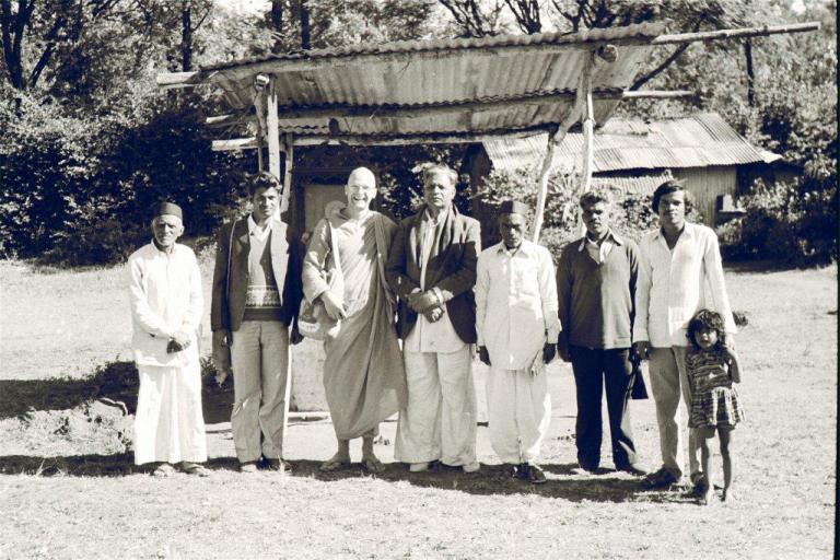 "This is at Panchgani, probably 1977. That was just quite typical of a Buddhist community desperate to have some knowledge, and there's an old man there in the middle who was the sort of leader, and he was very keen to learn meditation. He wanted to join us for meditation in the mornings but he said, ""The problem is that it's so cold here and I'm not well enough to have a bath before doing so."" He had the idea, an old Hindu idea that you had to have a bath before meditating. So we said look, don't worry, in Buddhism there's no such rule. It's not outward washing that's important, it's inward washing. That was quite an interesting encounter I had there. It was a lovely old community and people."