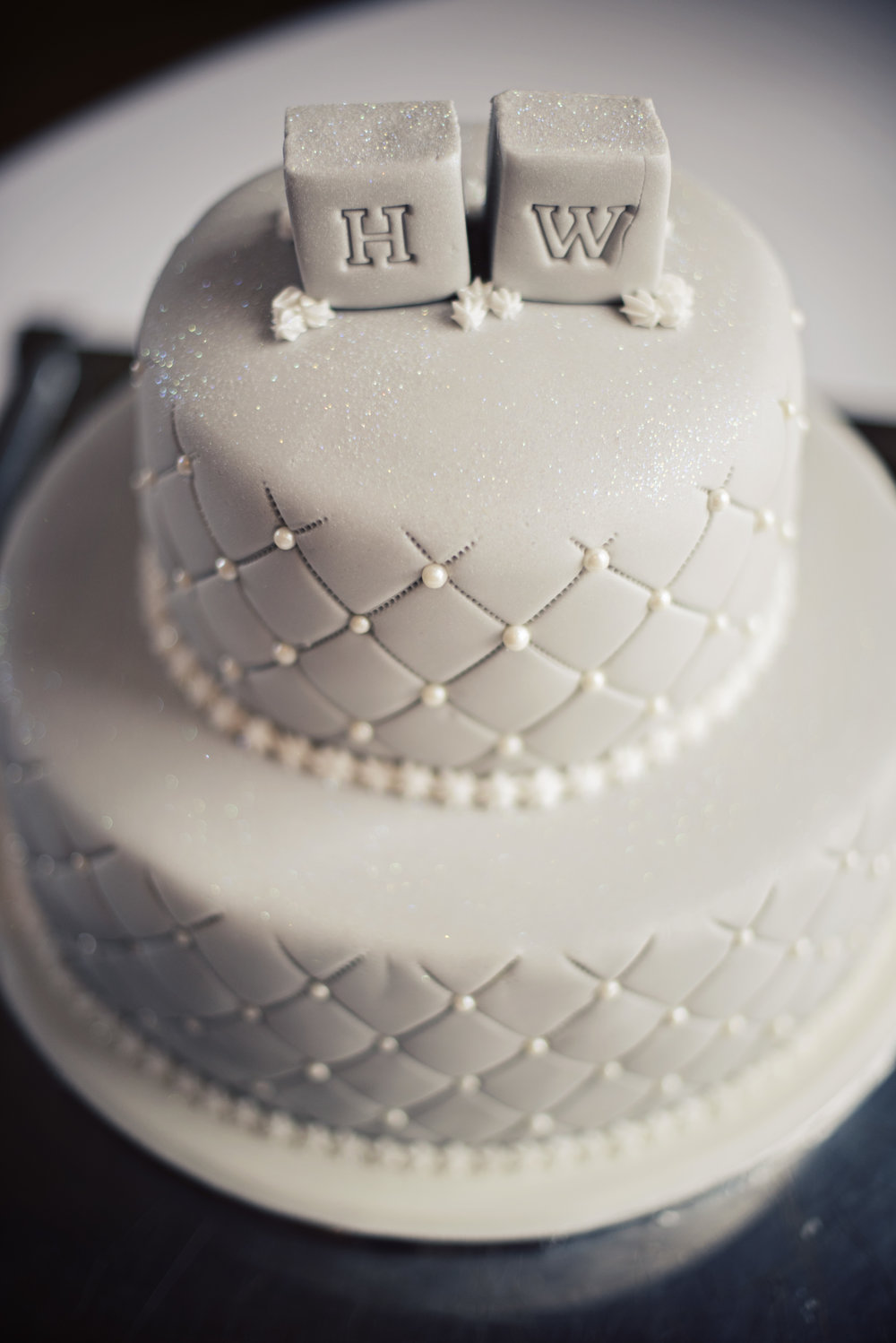The cake was simple and elegant in dove grey icing with pearly embellishments.