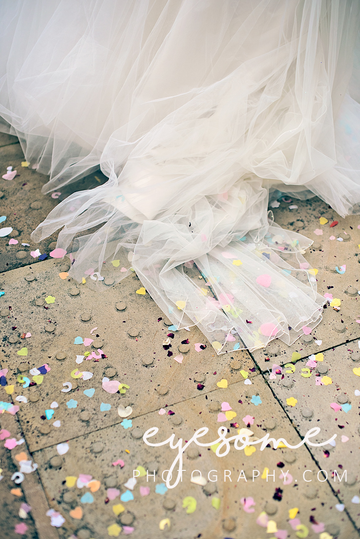 Yards of tulle and romantic confetti combined for this shot