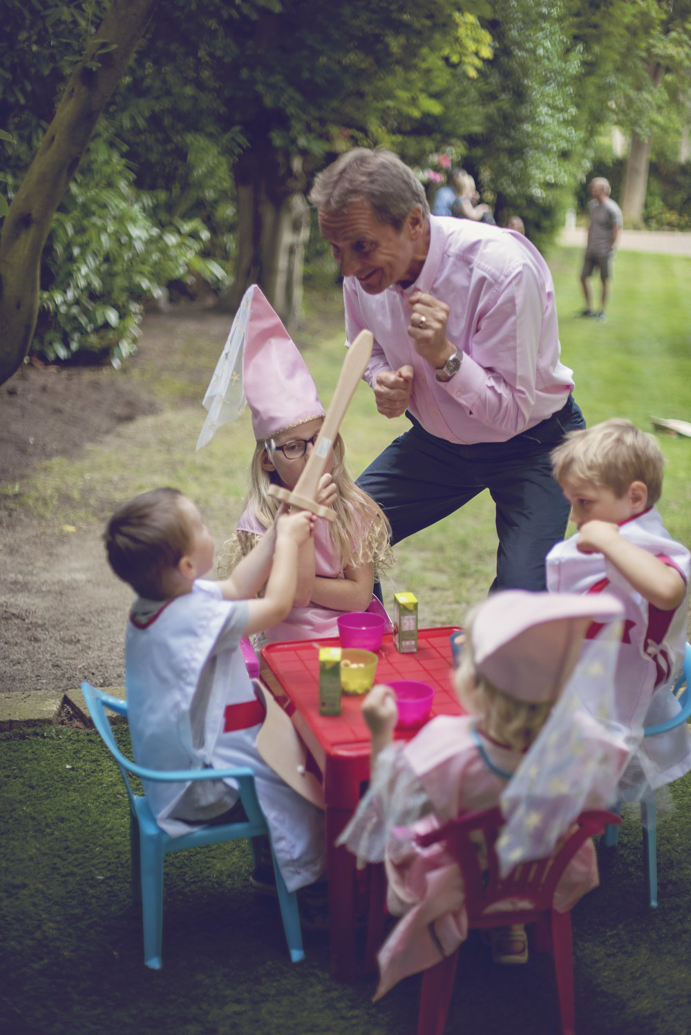 grandpa entertains the children over a picnic break from the war over the fort