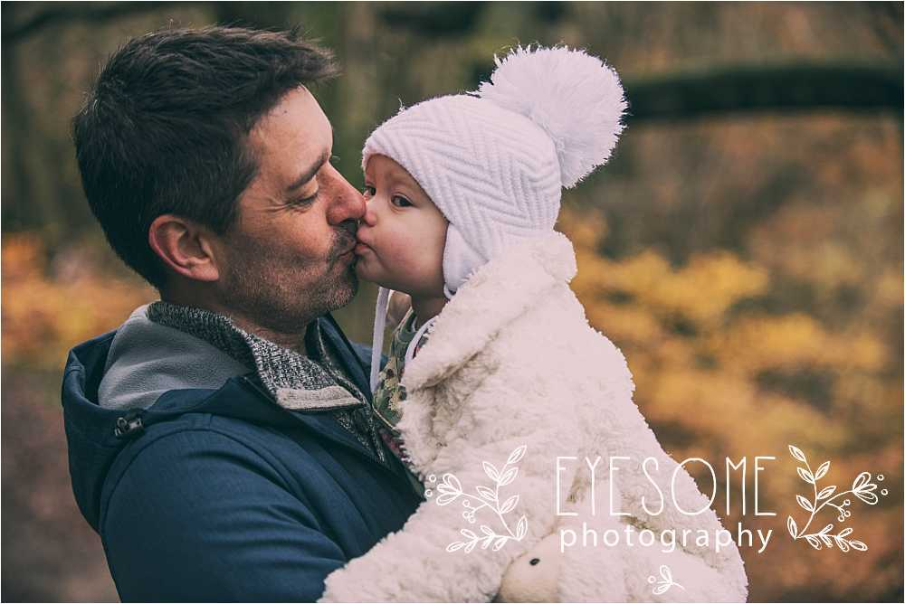A kiss for daddy, who was powerless to resist. The perfect moment.