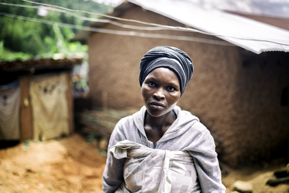 A coffee farmer at her home.