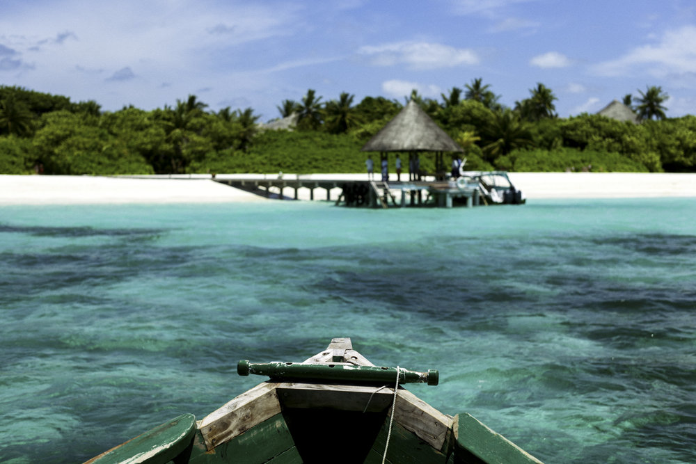 Approaching the island on a traditional Maldivian boat.