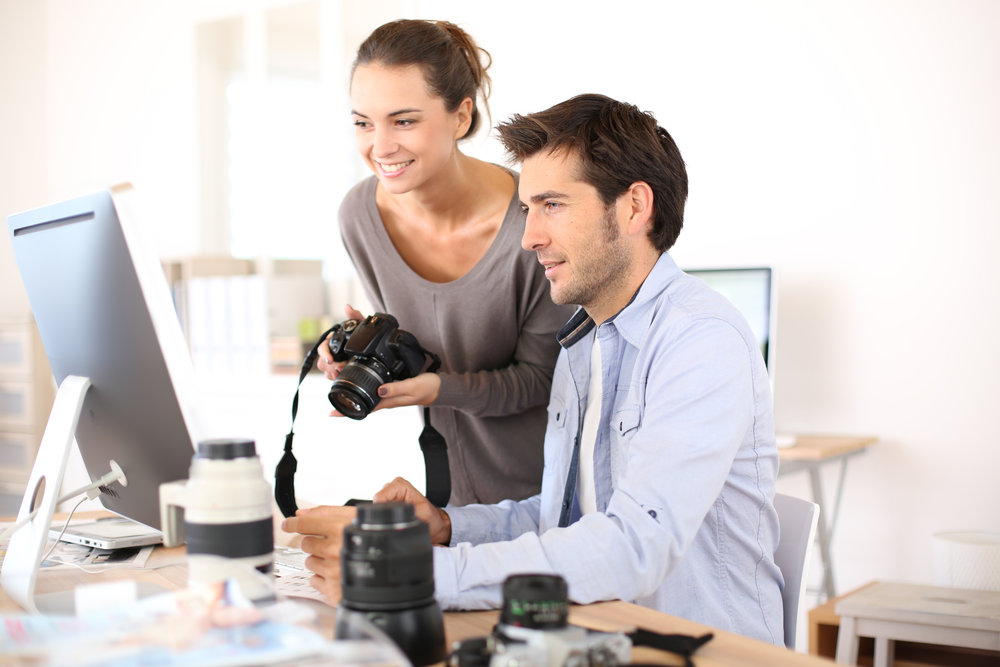 Photo reporters working in office