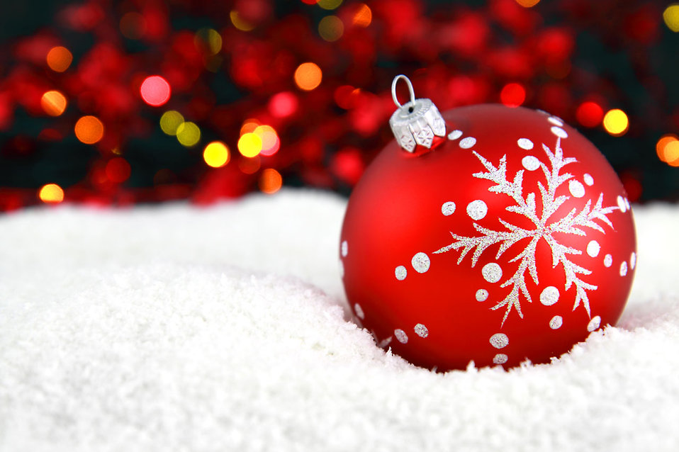 9156-a-red-christmas-ornament-in-the-snow-with-lights-in-the-background-pv.jpg