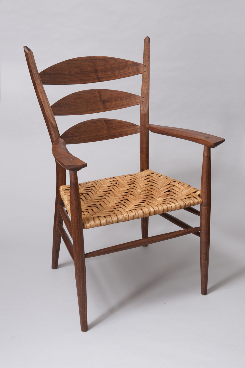 ... Is A Contemporary Version Of A Ladderback Arm Chair. The Chair Is Built  In American Black Walnut With A Natural Hickory Bark Woven Seat.