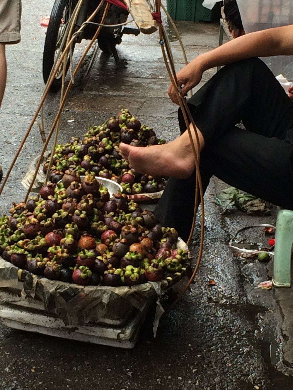 Sidewalk mangosteen seller
