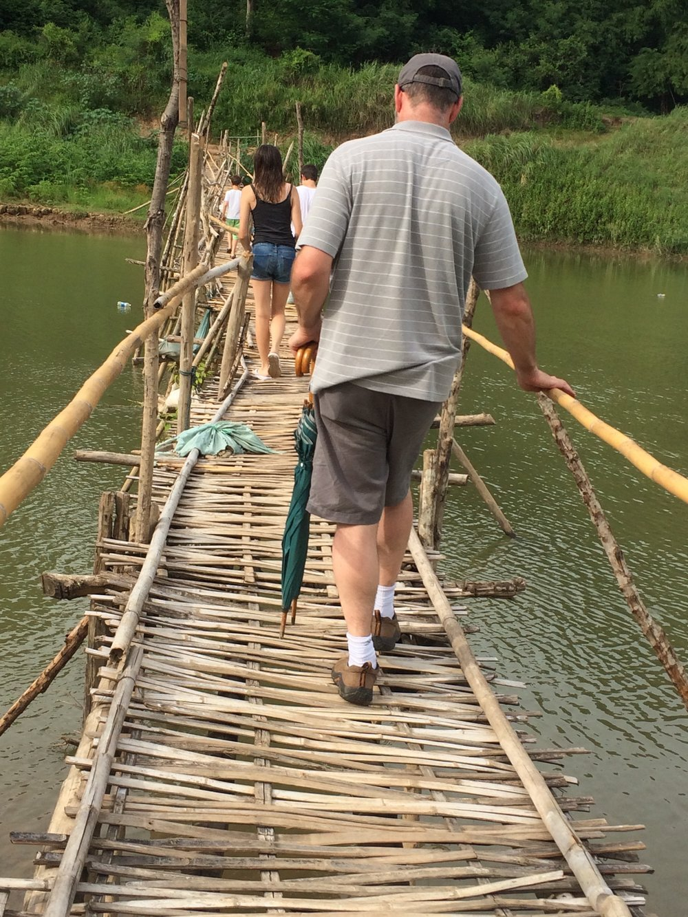 Villagers build this bridge, Mekong knocks it down, they build it again.