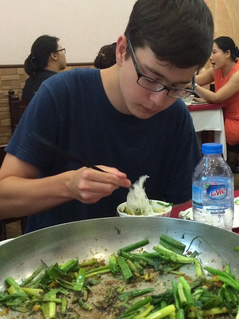 In Hanoi, the family-style food is often scooped onto fresh rice noodles