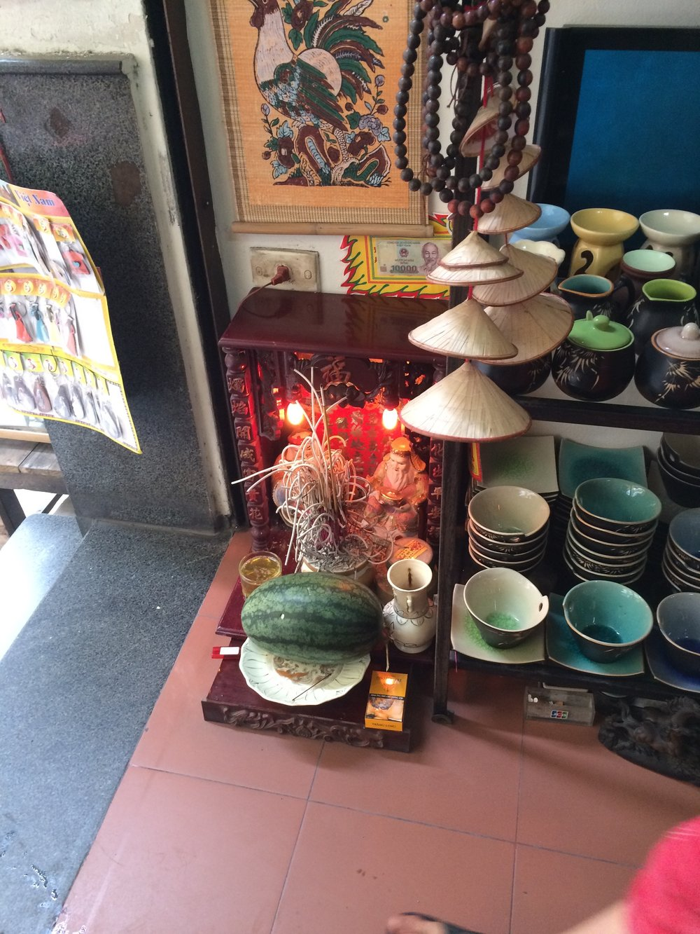 Why are these shrines in every Vietnamese home and business?
