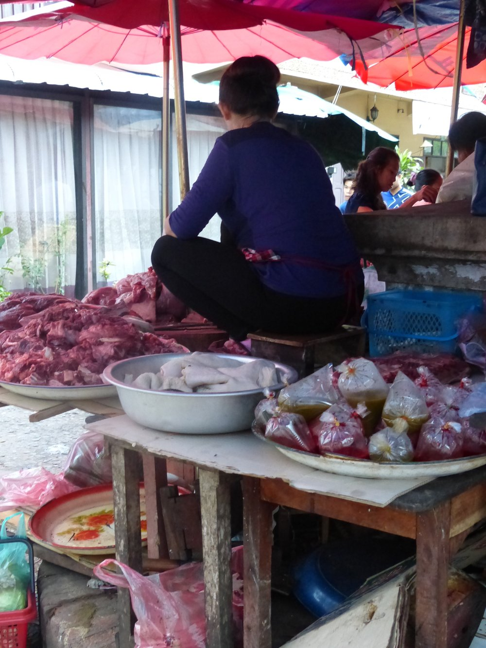 Wait, and butchers get up on the table in Laos?