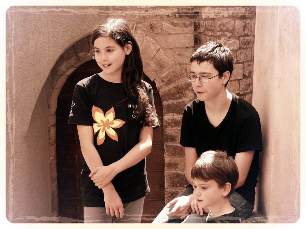 Our kids watching Infiorata procession in Spello, Umbria