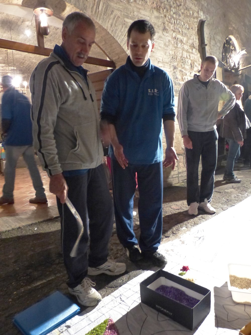Reviewing progress at Infiorata in Spello, Umbria