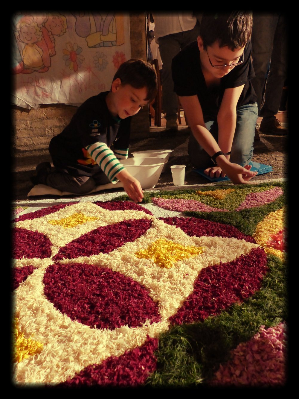 Brothers putting finishing touches at Infiorata in Spello, Umbria
